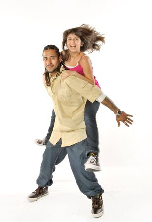 A Daughter hops up for her Father to give her a piggyback ride
