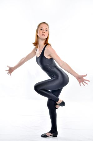 Jazz dancer in leotard and jazz shoes isolated on white