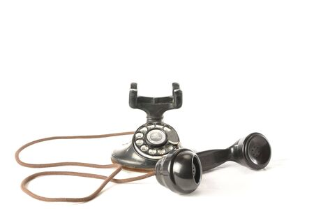handset: An antique telephone with handset off the hook Stock Photo