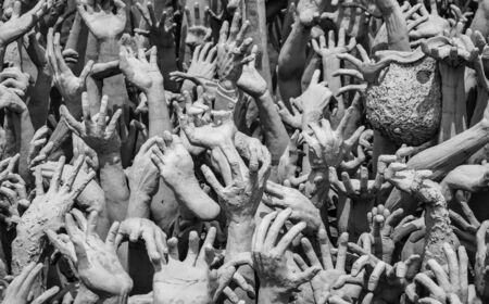 worse: Hands statue from hell in Wat Rong Khun Stock Photo
