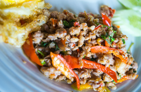 Stir-fried minced pork with holy basil and steamed rice photo