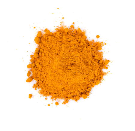 turmeric powder on white background. top view