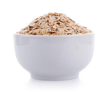 Oat flakes pile in white bowl on white