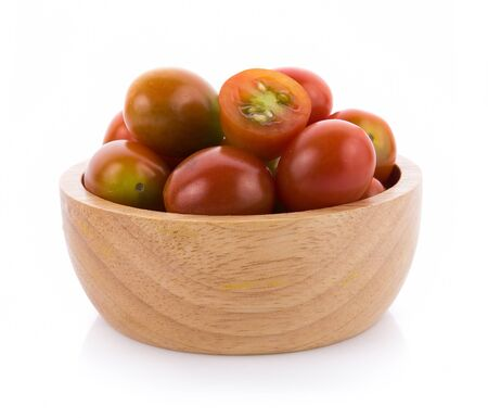 tomato in wooden bowl on white background