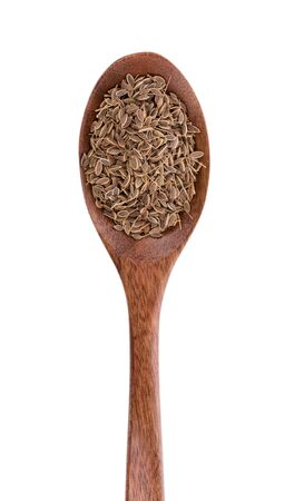 Pile of Caraway Seeds on wooden spoon