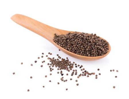 Perilla herb seed in wooden spoon on white background