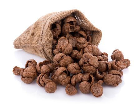 chocolate cereals on white background. Cornflakes