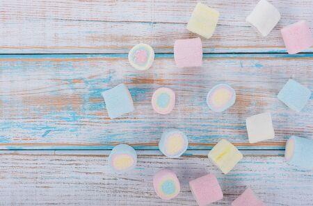 marshmallows on wooden background