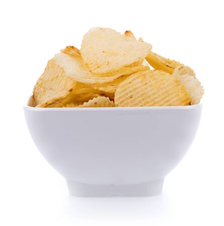 potato chips in bowl  isolated on white background 版權商用圖片