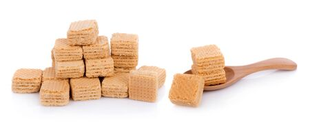 Milk wafers cubes on spoon isolated