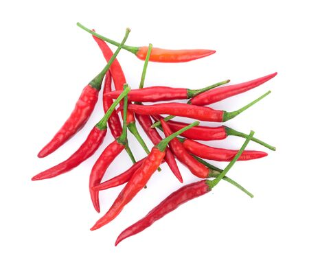 Pile of red paprika isolated on white background