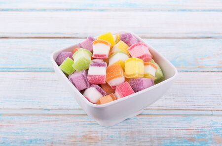 closeup colorful candy and jelly sweet on wooden