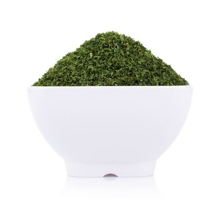 dried parsley in bowl isolated on white background 版權商用圖片