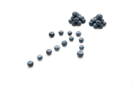 Arrow pointing two stack of blueberries photo