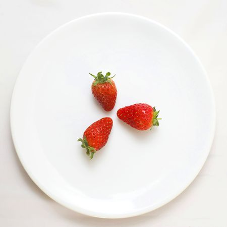 Three strawberry on plate Stock Photo - 4657989
