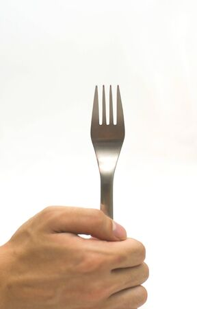 stabs: Hand holding fork