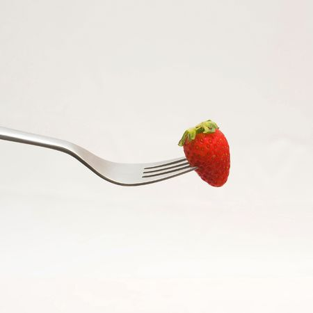 penetrated: Strawberry on fork
