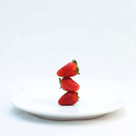 Red strawberries stack among each other Stock Photo