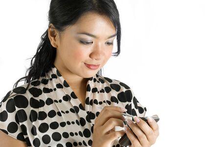 Female asian business woman using PDA Stock Photo - 4733257