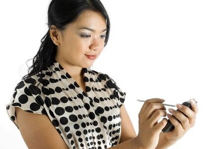 Female asian business woman using PDA  Stock Photo - 4756477