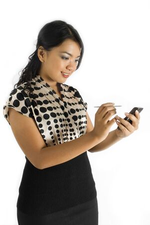 Female asian business woman using PDA smiling Stock Photo - 4756470