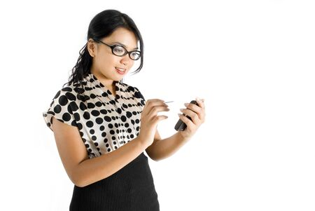 Nerdy female asian business woman using PDA smiling photo