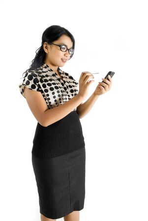Nerdy female asian business woman using PDA smiling Stock Photo - 4733466