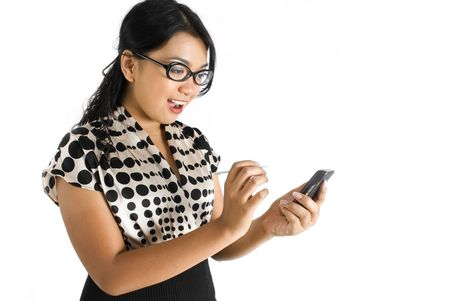 Nerdy female asian business woman using PDA shocked Stock Photo - 4756370