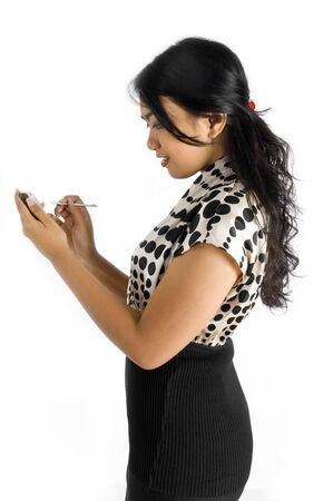 Side view of Female asian business woman using PDA Stock Photo - 4733550