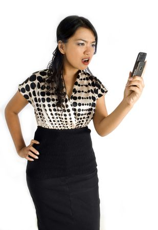 Female asian business woman furious with mobile phone