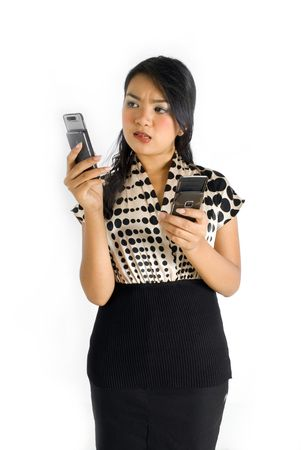 Female asian business woman thinking and busy with a pair of mobile phone photo