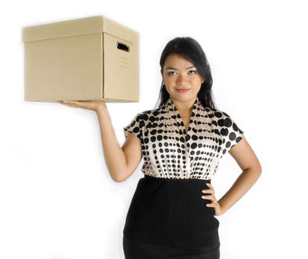 Female asian business woman carrying a box with one arm photo