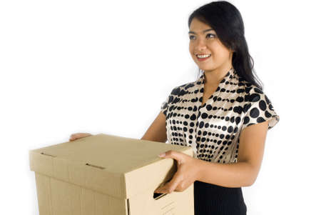 Female asian business woman giving brown package box smiling Stock Photo - 4733365