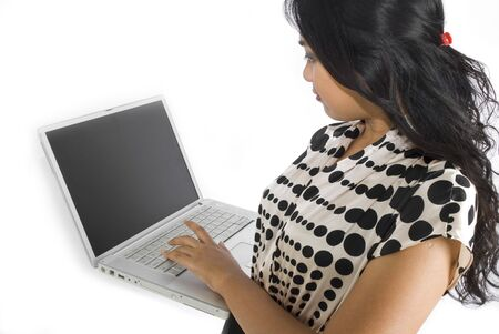 Female asian business woman looking at laptop Stock Photo - 4733346
