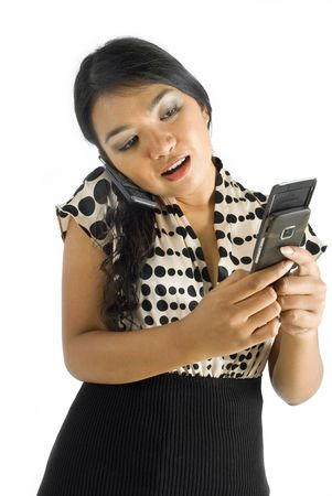 Asian female business woman typing sms and talking on phone Stock Photo - 4748119