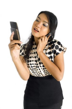 Female asian business woman shocked and busy with a pair of mobile phones Stock Photo - 4733411