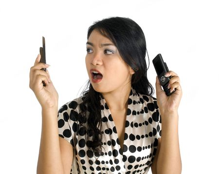 Female asian business woman shocked and busy with a pair of mobile phones Stock Photo - 4756361