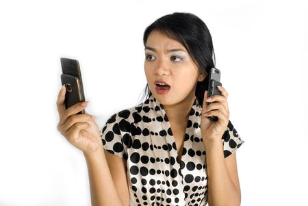 Female asian business woman shocked and busy with a pair of mobile phones Stock Photo - 4756363