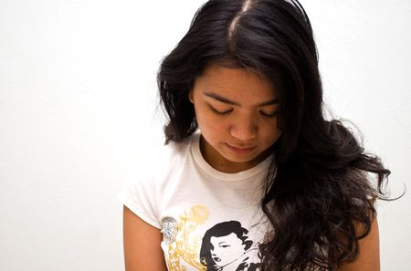 Asian girl looking down, despair photo