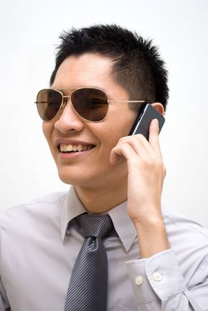 Asian business male with shades talking on cellphone photo