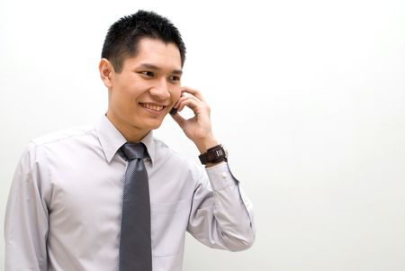 phoning: Asian business male talking on phone, happy Stock Photo