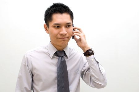 Asian business male talking on phone, calm photo