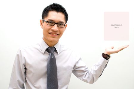 Asian business male presenting product