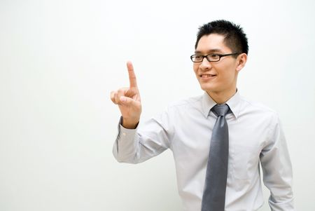 Nerdy Asian business male activating a button - happy