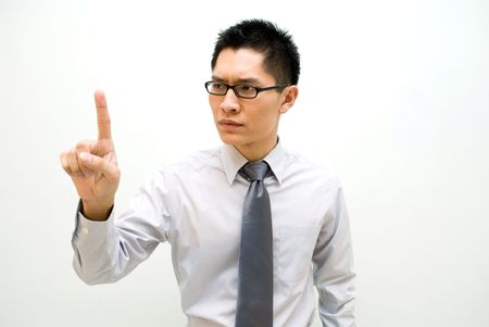 envisage: Nerdy Asian business male activating a button - serious Stock Photo