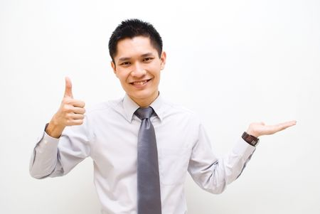 Asian business male with thumbs up showing off product