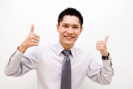Asian business male with two thumbs up Stock Photo - 4973279