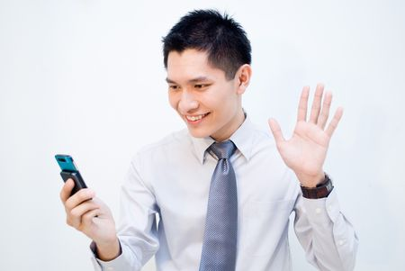 Asian business male video call - waving hi photo