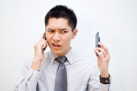 Asian male frustrated over phone call