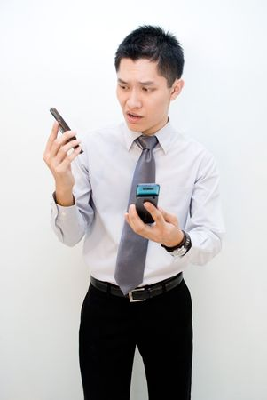 Asian male frustrated over phone Stock Photo - 4976336